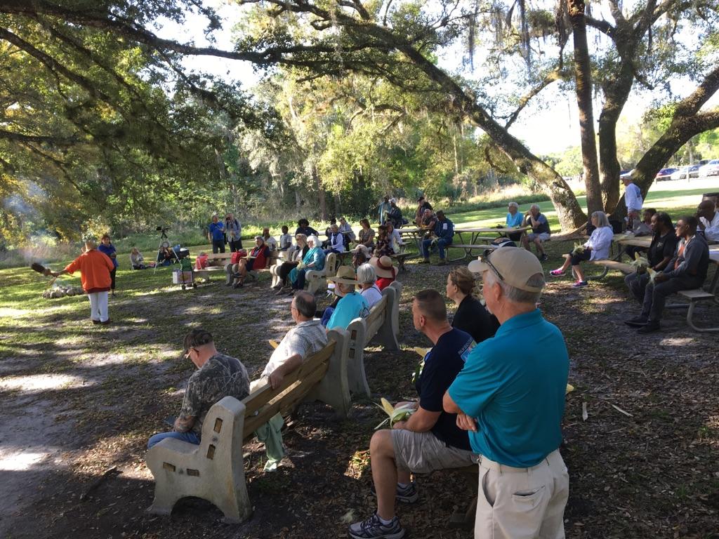 Carib Traditional Queen (in orange jacket) opens ceremony for Annual Seminole Maroon Commemorative in Loxahatchee River Battlefield Park.