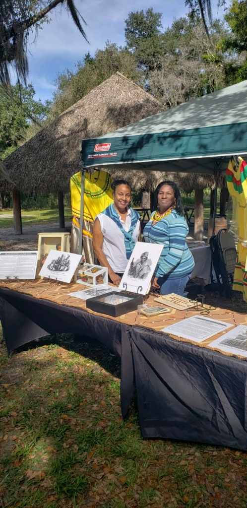 Seminole descendants and event planners, Michelle Riley and Antoinette Riley, at booth at 2020 Annual Seminole Maroon Event at Loxahatchee River Battlefield Park, January 19, Jupiter, FL.