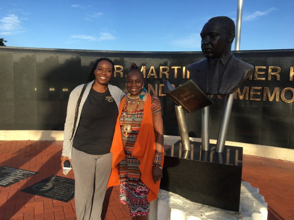 Seminole descendant and keynote speaker Windy Goodloe, from Brackettville, Texas (left), with, FBHRP President Dr. Wallis Tinnie at the Dr. Martin Luther King Jr. Memorial om Flagler Drive near downtown West Palm Beach.